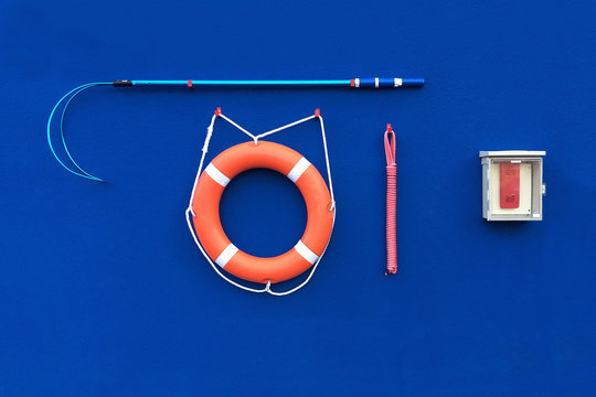 Lifeguard Water Rescue equipment set on Blue wall Background.