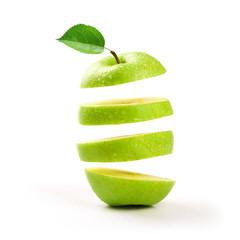 sliced green apple levitating on white background