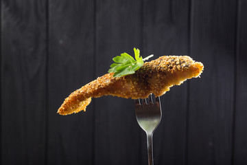 Pieces of fried Fish on a fork