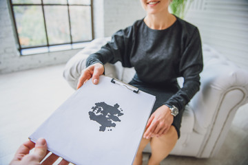 Consulter showing paper with inkblot