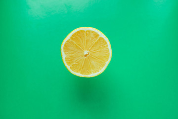 a half of a lemon on a green background.pop art