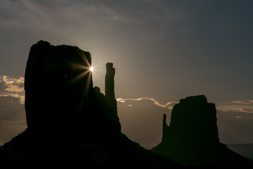 Morning Mittens - The sun rises behind the Left Mitten at Monument Valley
