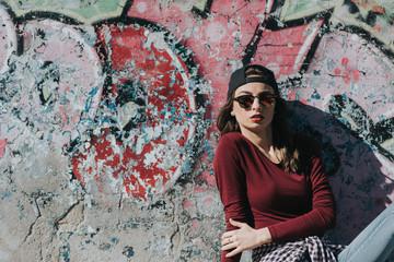 Young stylish female skateboarder
