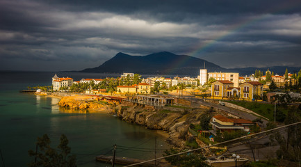 Urban landscape with a rainbow in Loutra Edipsou, Evia, Greece