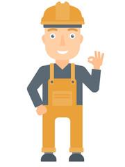 Smiling builder showing ok sign.