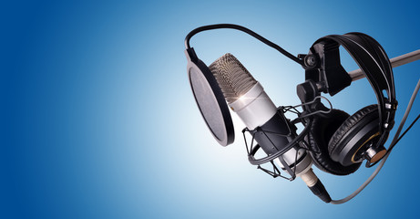Studio condenser microphone and equipment blue isolated