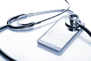 Stethoscope on smartphone with broken screen