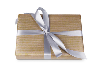 Christmas holiday gift box in golden paper isolated on white