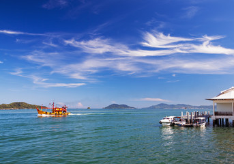 Seascape with boats and picturesque clouds. Borneo island, Malaysia.