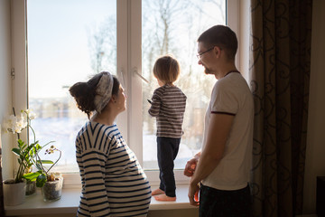 happy family with  son kid toddler playing near window real inte