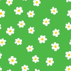 Fun flowers seamless pattern. Cartoon chamomile on grass green background. Vector illustration.