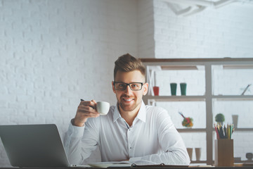 Handsome guy with coffee cup