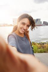 beautiful woman smiling and talking selfie
