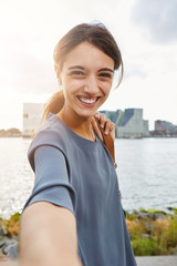 cheerful young woman talking selfie and smiling