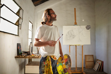 portrait of anartist in his painting studio