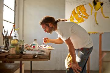 Man painting in his artist studio