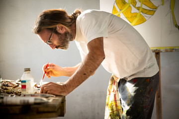 Painter at work in his art studio