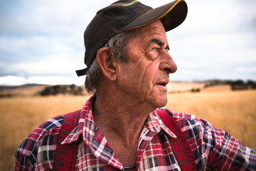 close portrait of a working older farmer