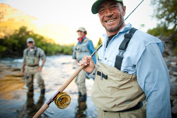 Three men enjoying the outdoors during a flyfishing trip in southern Argentina.