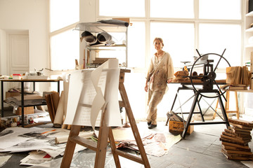 Portrait of a female artist in her light filled studio
