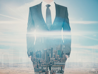 Businessman on city background multiexposure