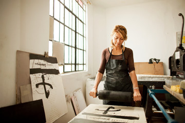 Female artist at work in her studio