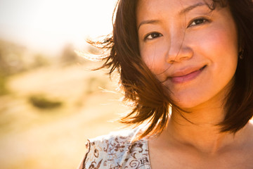 Close portrait of a young asain woman outdoors