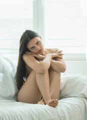 Beautiful girl on the bed