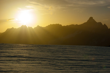 Sunset on the highest Alps peaks. From the Matterhorn glacier, Zermatt, Switzerland.