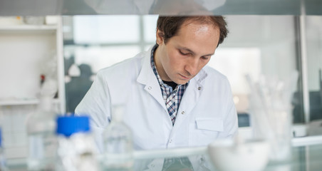 Male laboratory researcher performs tests