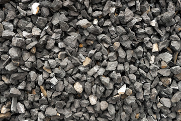 coarse aggregate - a stack of gravel / grit crushed and broken at a stone pit. The colors, sizes and shapes are very irregular.