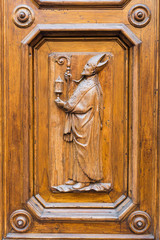 wood carving at a historic door in Florence