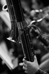 Detail of contrabassoon in the orchestra closeup in black and white
