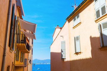 typical pastel colored houses in Saint Tropez