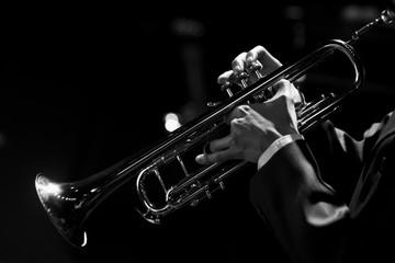 Keuken foto achterwand Muziek Hands of the musician playing a trumpet closeup in black and white