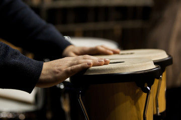 Hands musician playing the bongos