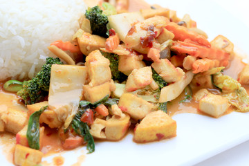 Stir Fried Tofu with Gravy Sauce and mixed vegetables in white plate on white background. Vegetarian Food, healthy food.