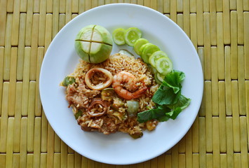 spicy fried rice seafood and pork with eggplant in shrimp paste sauce on dish