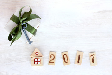 its own property in 2017/ Gift with green ribbon and a small key near layout of the house and numbers