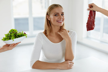 Healthy Beautiful Woman Choosing Between Meat And Salad