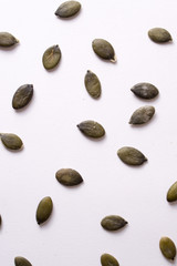pumpkin seeds on white background