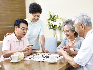 Senior people playing Weiqi at home