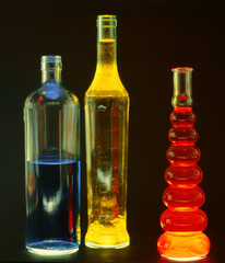 beautiful glass bottles filled with colored liquids