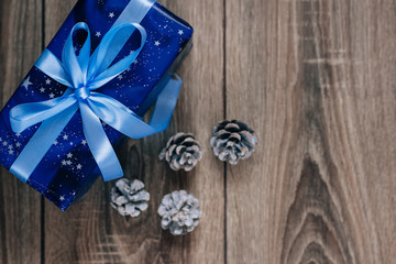 Gift box and a cone on  Christmas background
