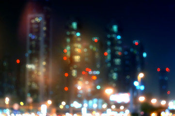 Defocused urban abstract texture blurred background with bokeh of city lights on street at night