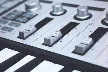 Close up MIDI Controller, keys  and faders
