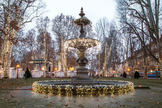 Illuminated fountain in Zrinjevac park, Zagreb, Croatia, Christmas market, Advent