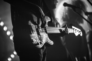 Electric bass guitar player, monochrome