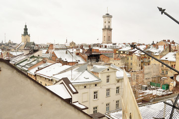 Old buildings and snow-covered roofs of the downtown in Lviv, Ukraine.