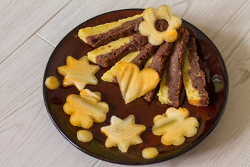 Moist cake with orange and chocolate. Decorated cutting persimmon shape flowers, star and heart.